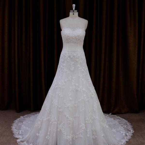 Exquisite Strapless A Line Wedding Dress With Detachable Jacket